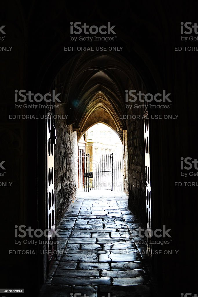 Dark Corridor in Gloucester Cathedral stock photo