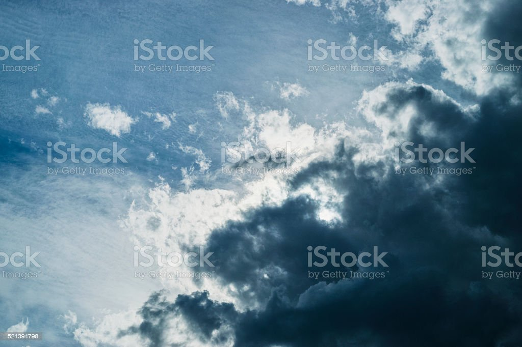 Dark Cumulus clouds roll in to block to sun stock photo
