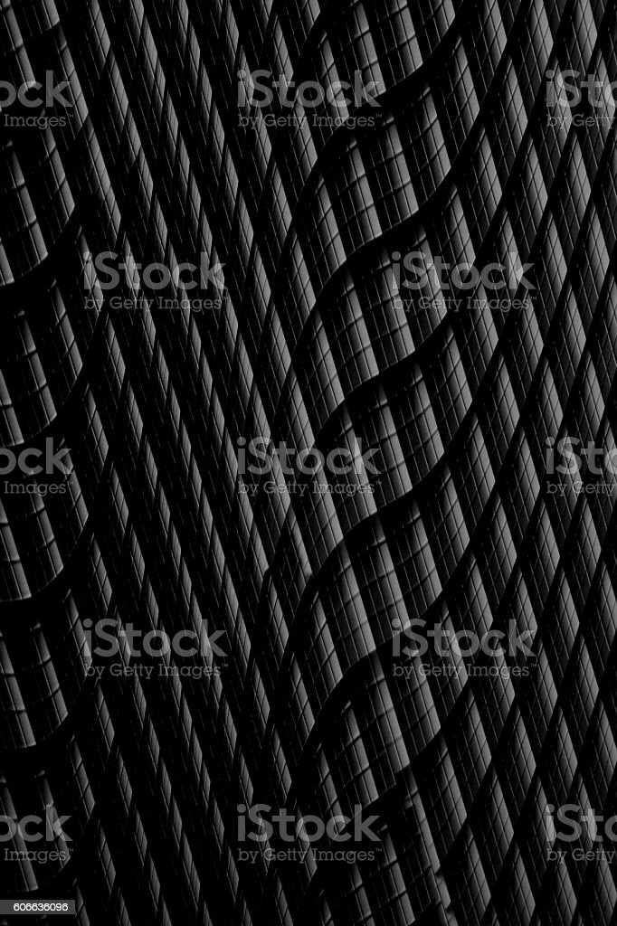 Dark curvilinear surface with openings resembling contemporary / constructivist architecture stock photo