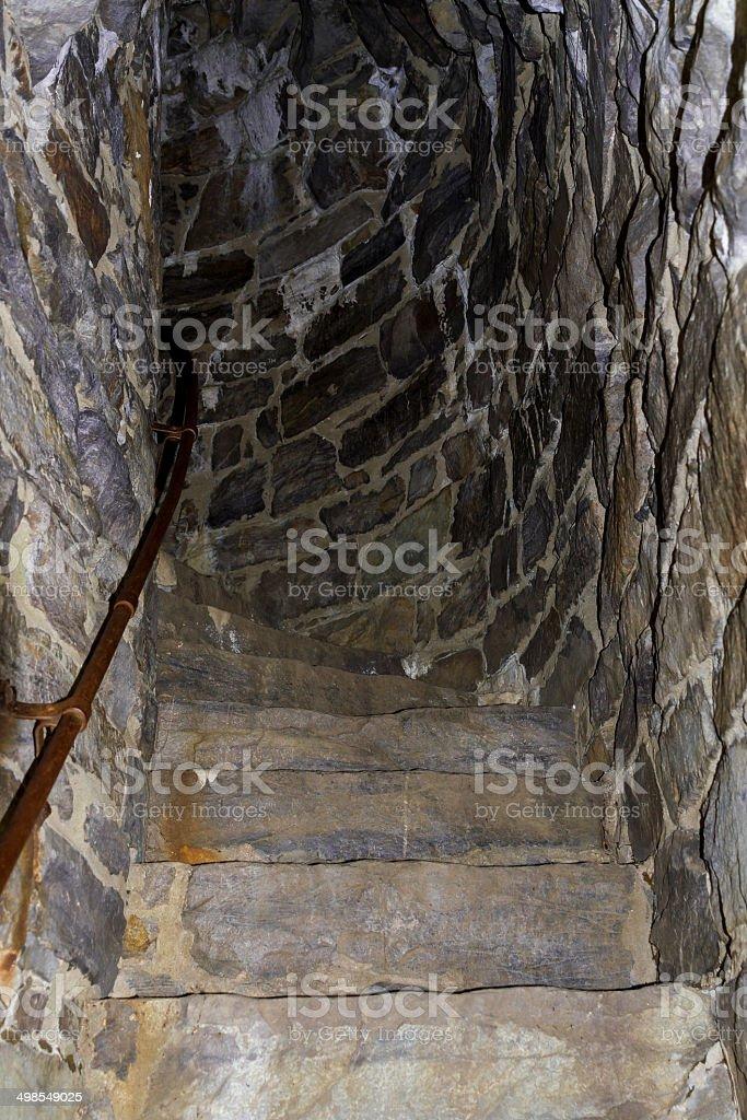 Dark, Curving Stone Stairway stock photo