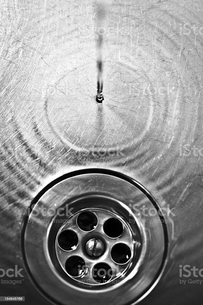 dark drain with water stock photo