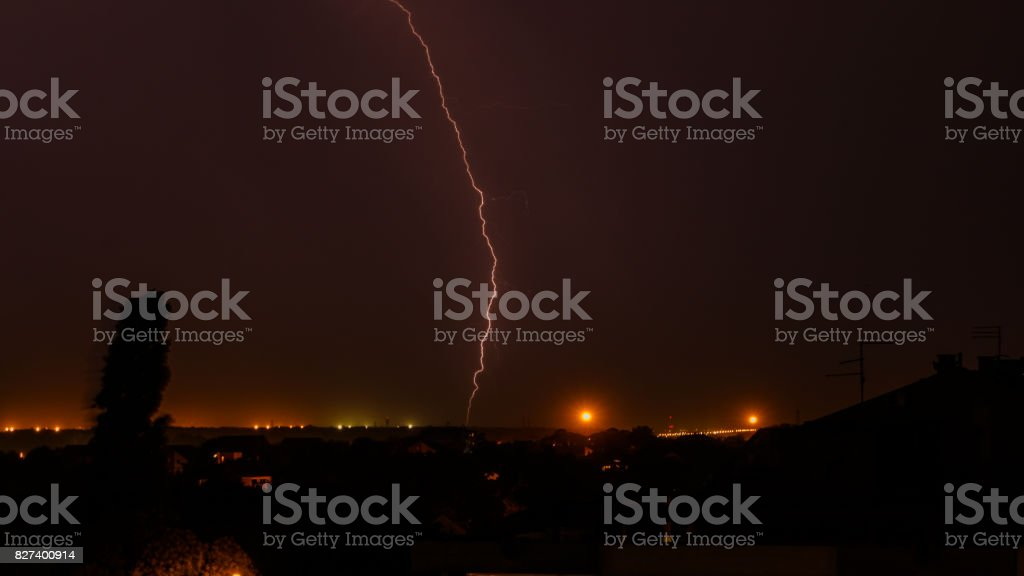 Dark dramatic cloudy storm sky with lightning stock photo