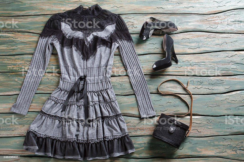 Dark dress and heel shoes. stock photo