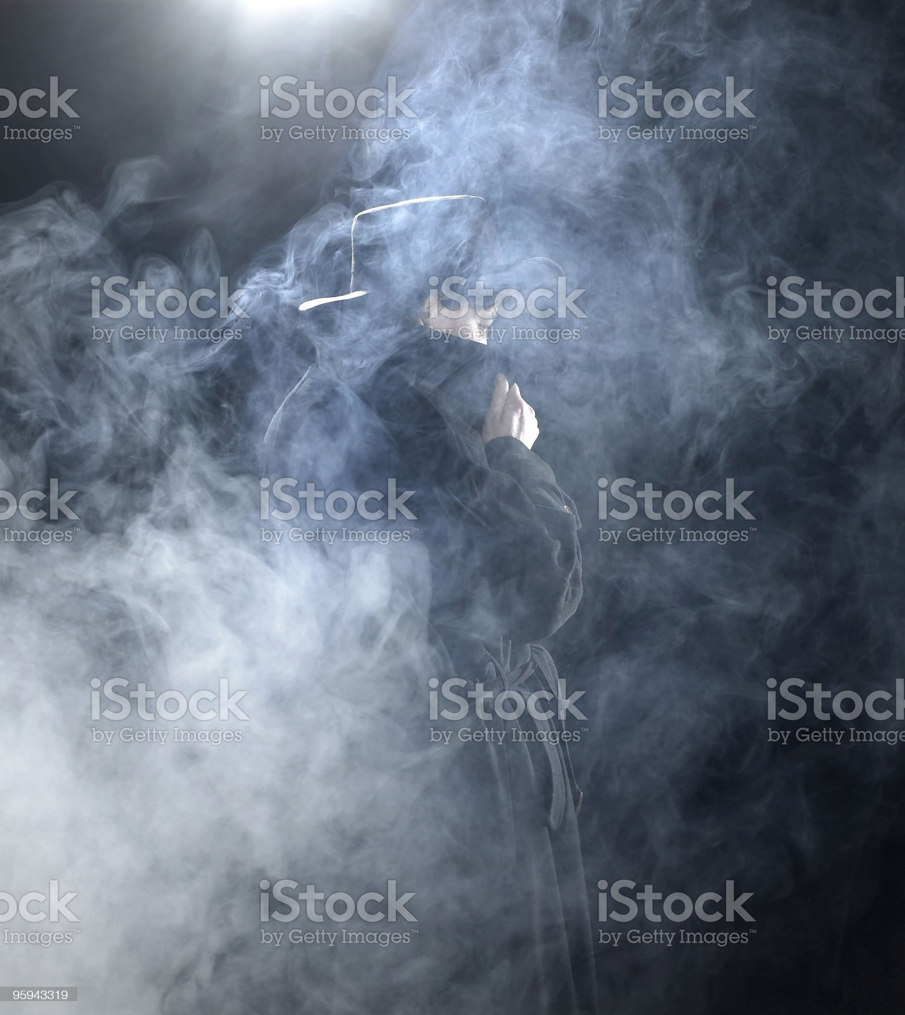 dark dressed woman in smoky ambiance royalty-free stock photo