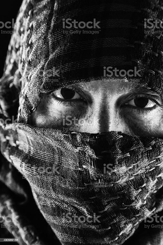 Dark Eyed Man Wearing A Keffiyeh stock photo