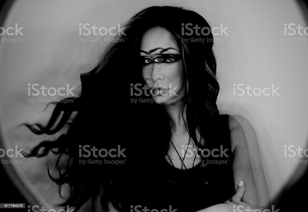 Dark fantasy portrait of magician woman, third eye, witch concept stock photo