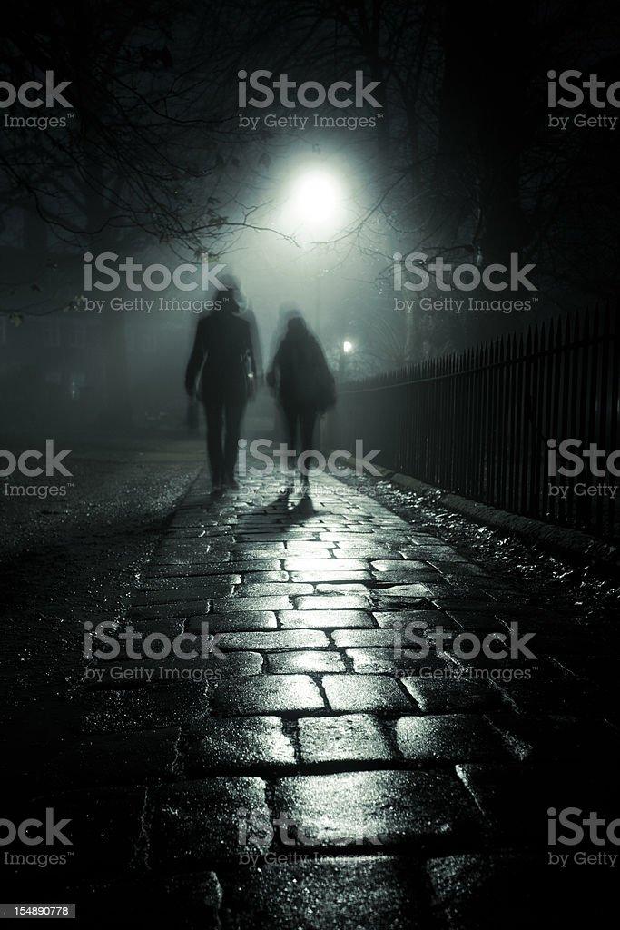 Dark foggy alley stock photo