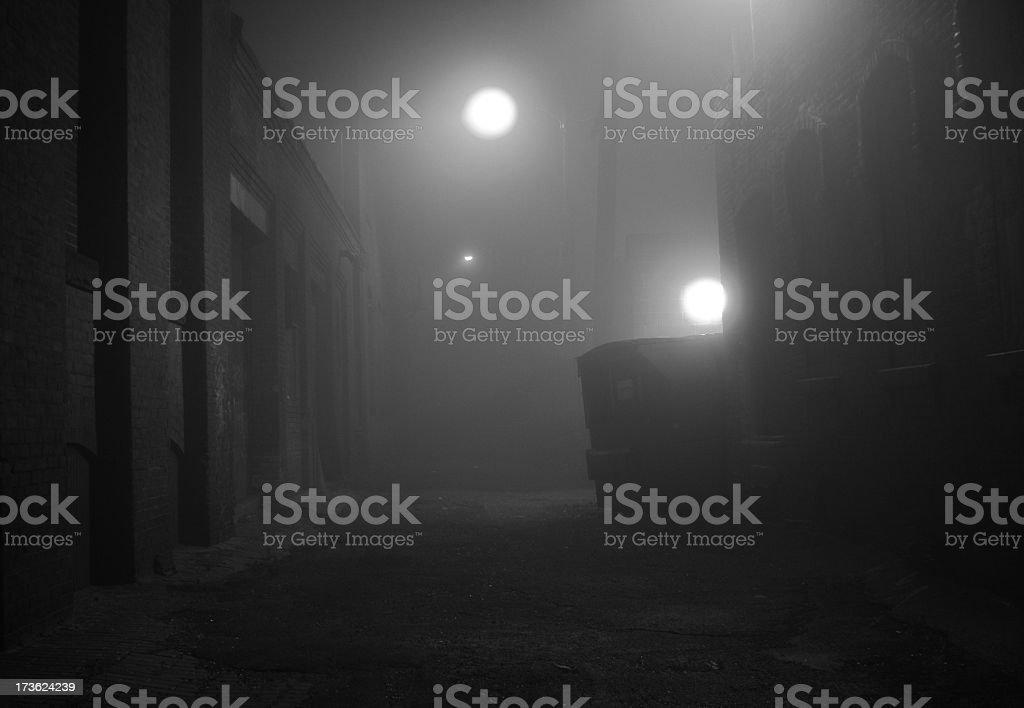 Dark Foggy Urban Alleyway in Black and white stock photo