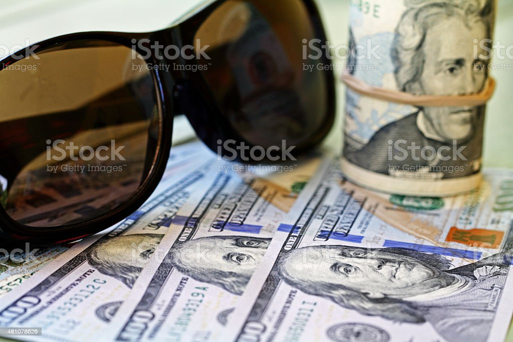Dark glasses with US currency stock photo
