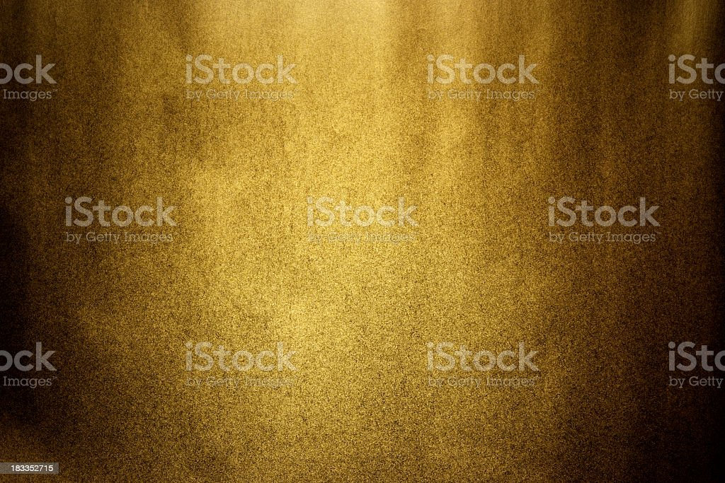 Dark gold texture background with spot light stock photo