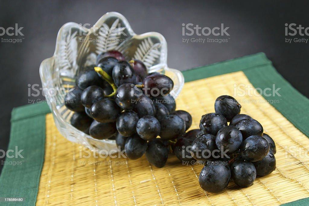 Dark grape and glass bowl royalty-free stock photo