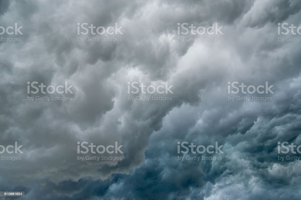 Dark gray and blue storm clouds stock photo