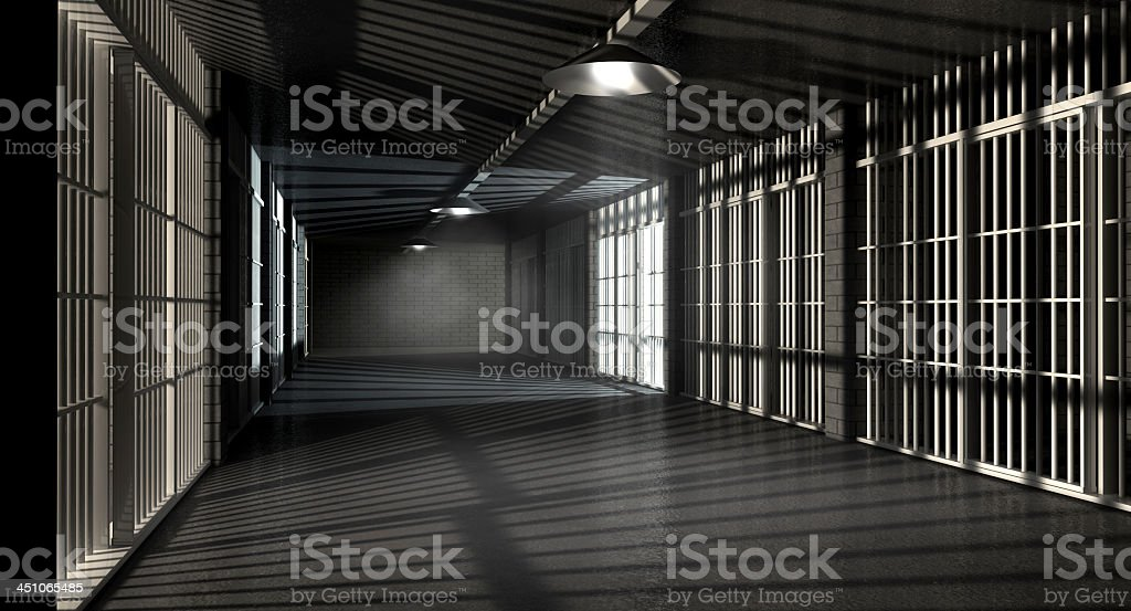 Dark gray corridors and cells with bars in a jail stock photo