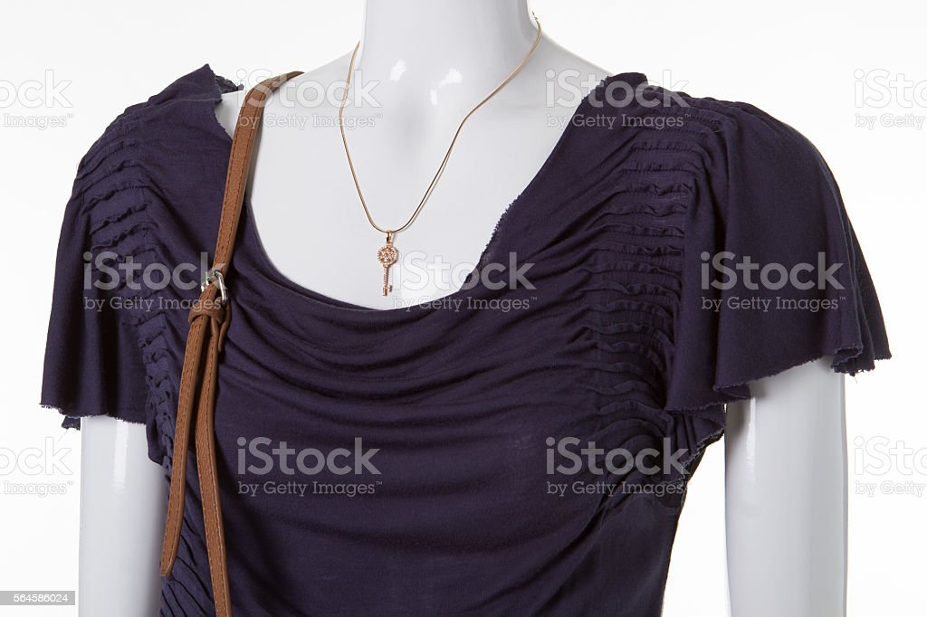 Dark gray dress and jewelry. stock photo