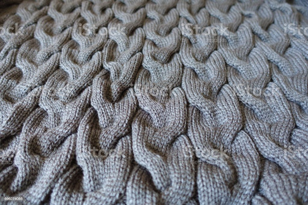 Dark gray knit fabric with braid pattern stock photo