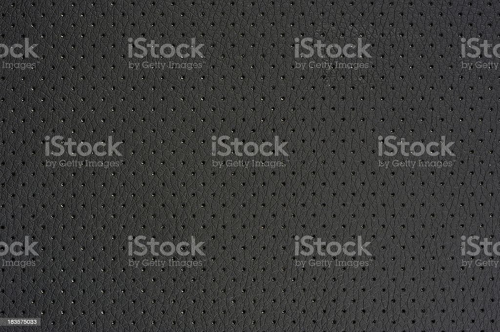 Dark Gray Perforated Artificial Leather Background Texture stock photo