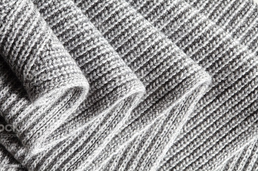 Dark gray ruched knitted wool fabric cool weather background stock photo