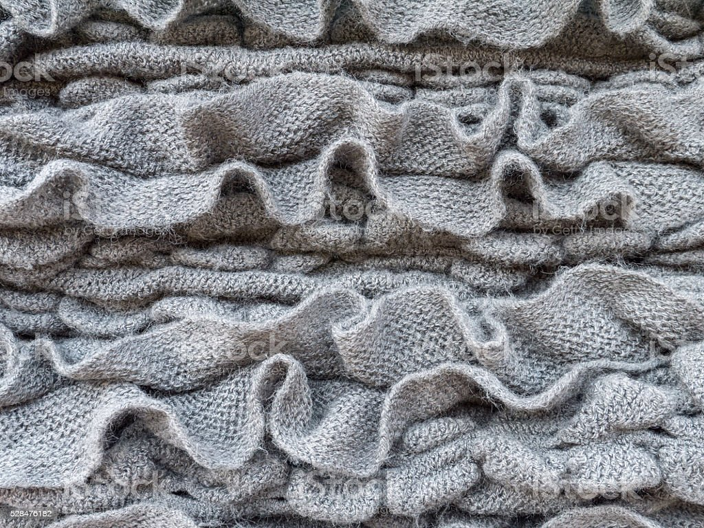 Dark gray ruched knitted wool fabric stock photo