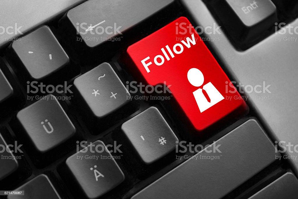 dark grey keyboard red button follow stock photo