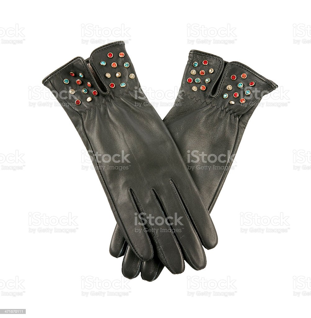 Dark grey leather gloves with colorful crystals stock photo