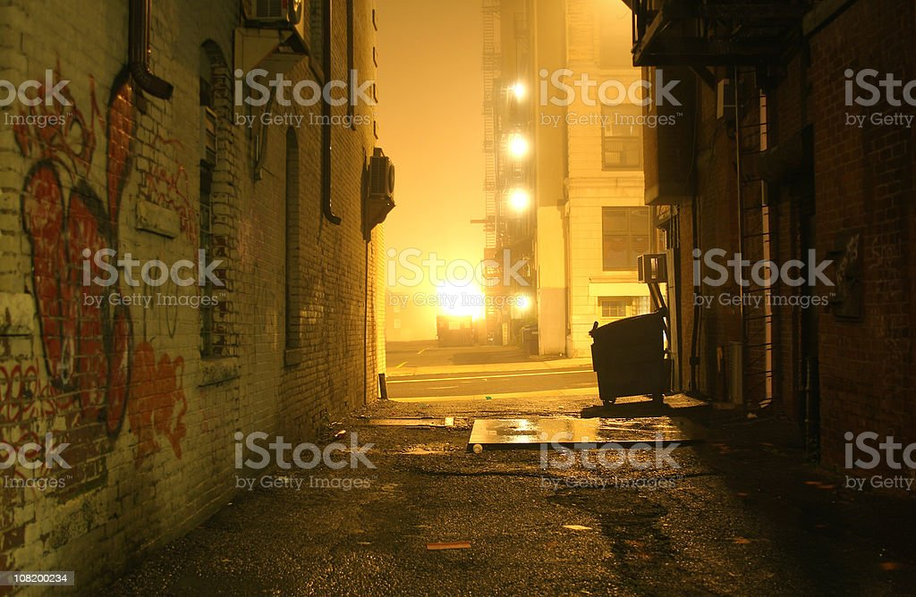 Dark Grunge Alley with Lights Shining at Night stock photo