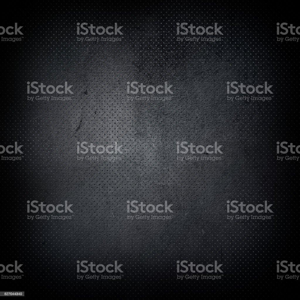 Dark grunge perforated metal background stock photo