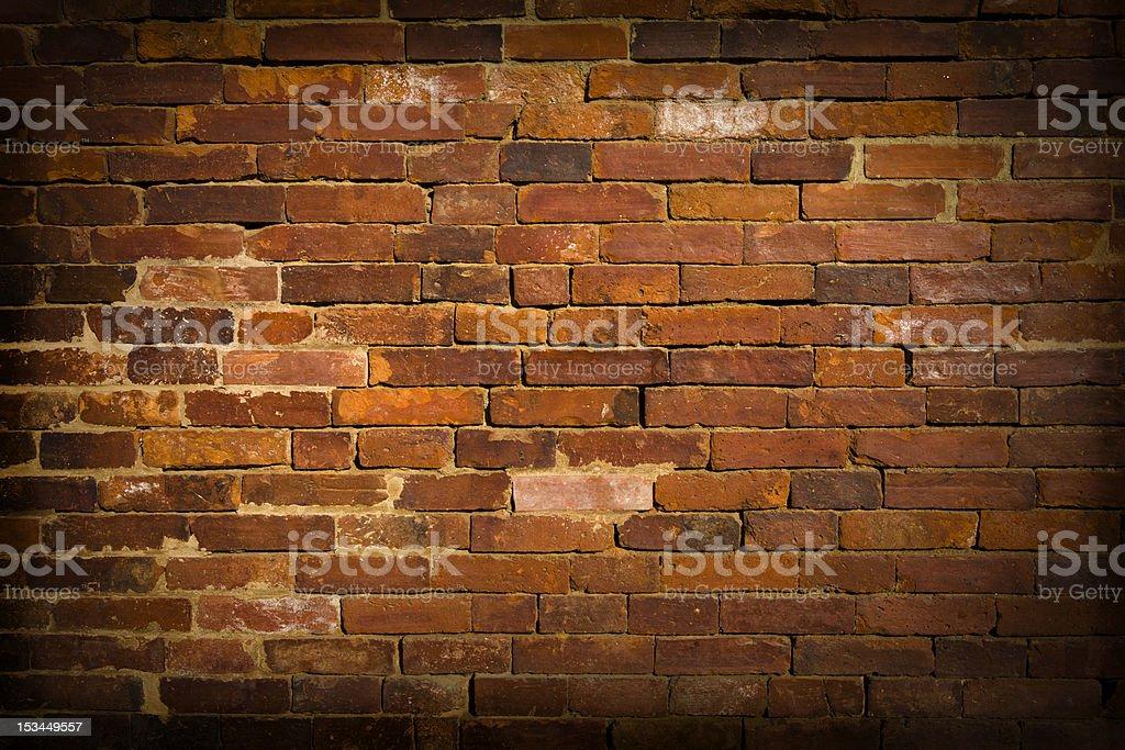 Dark, grunge, weathered and crumbling brick wall. royalty-free stock photo