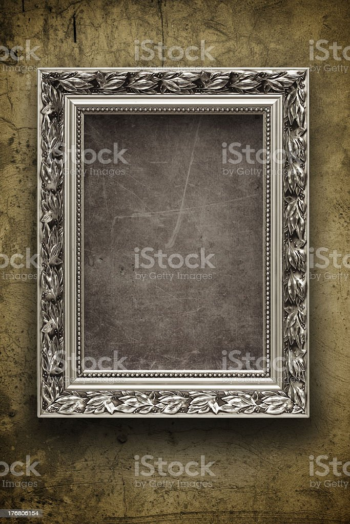 Dark, grungy wall with silver frame royalty-free stock photo