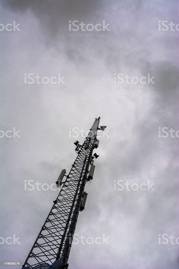 Dark gsm tower stock photo