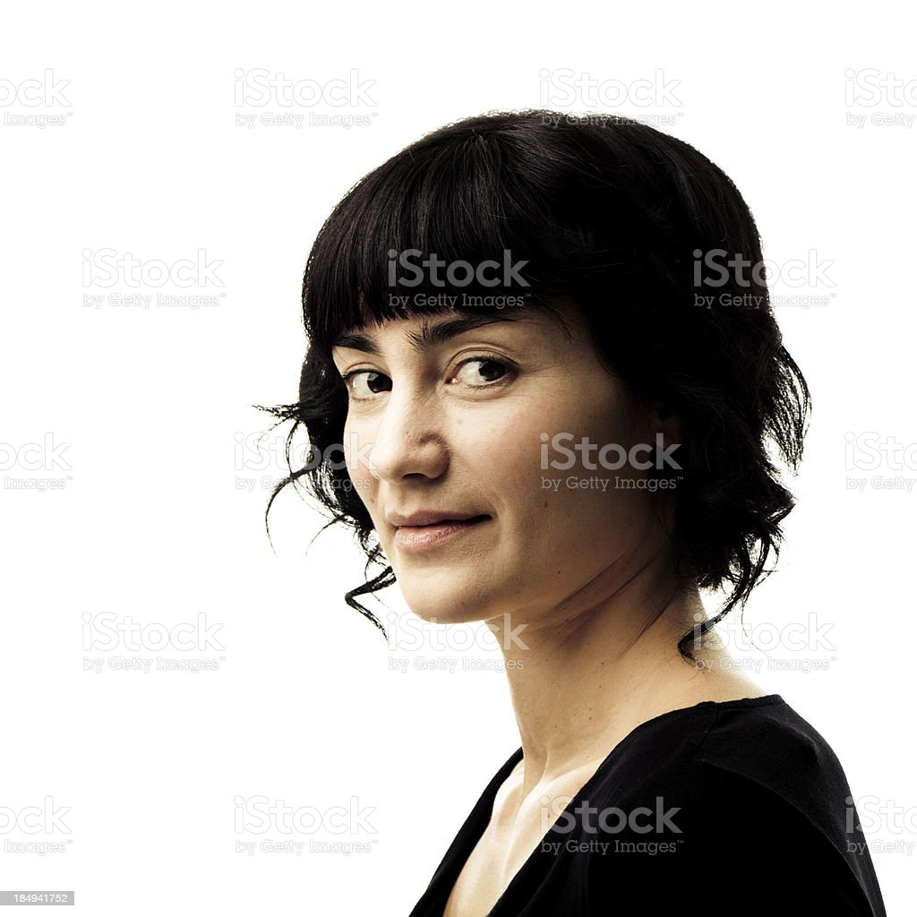 Dark haired women with a slight smile on white background royalty-free stock photo