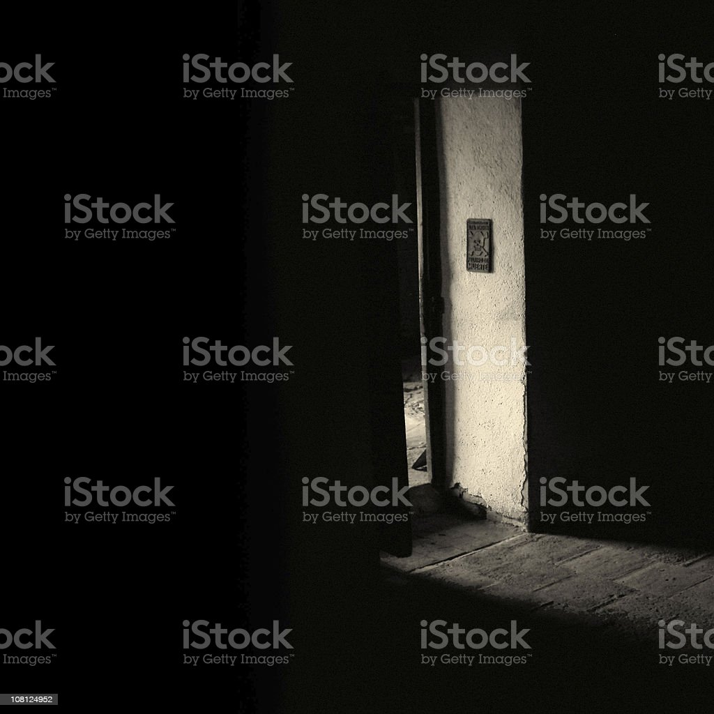 Dark Hallway with Doorway in Light, Black and White royalty-free stock photo