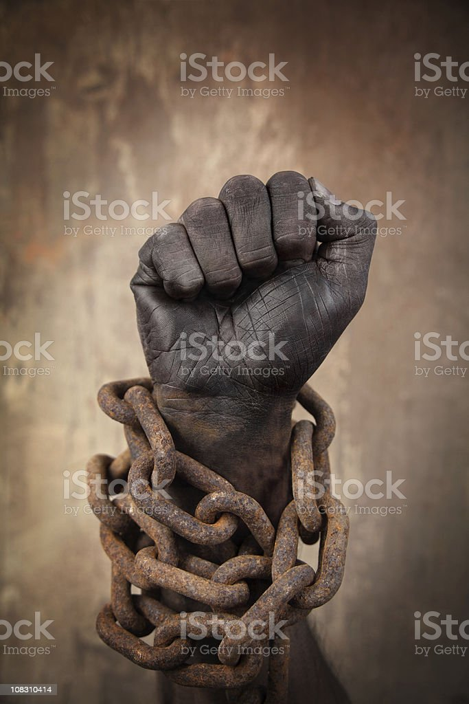 Dark Hand in Heavy Chains stock photo