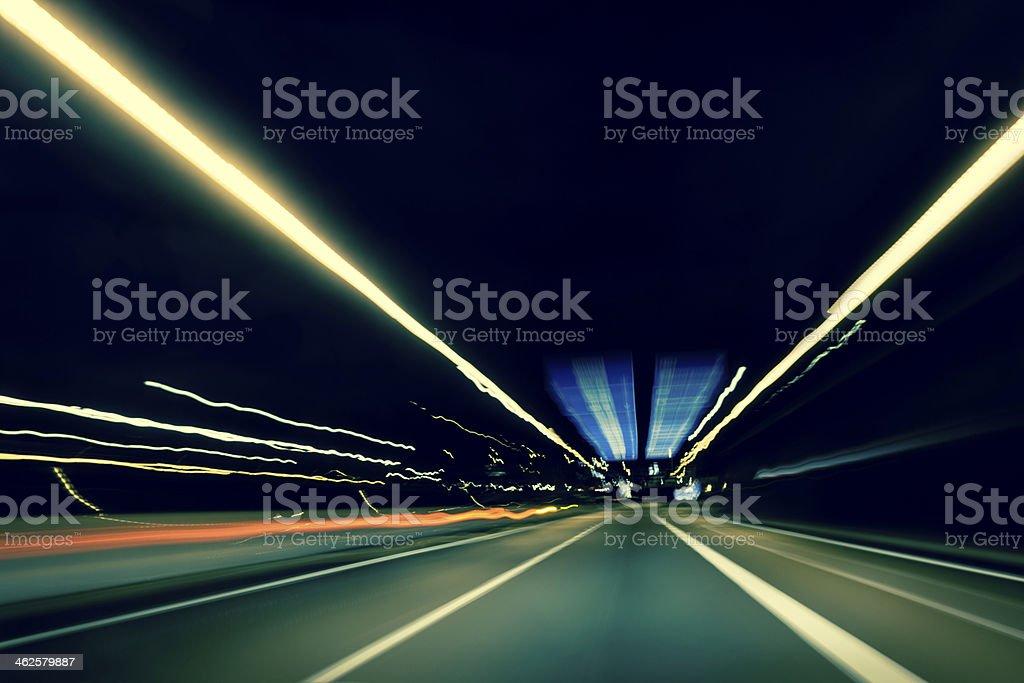 Dark highway at night, with streaks of light stock photo