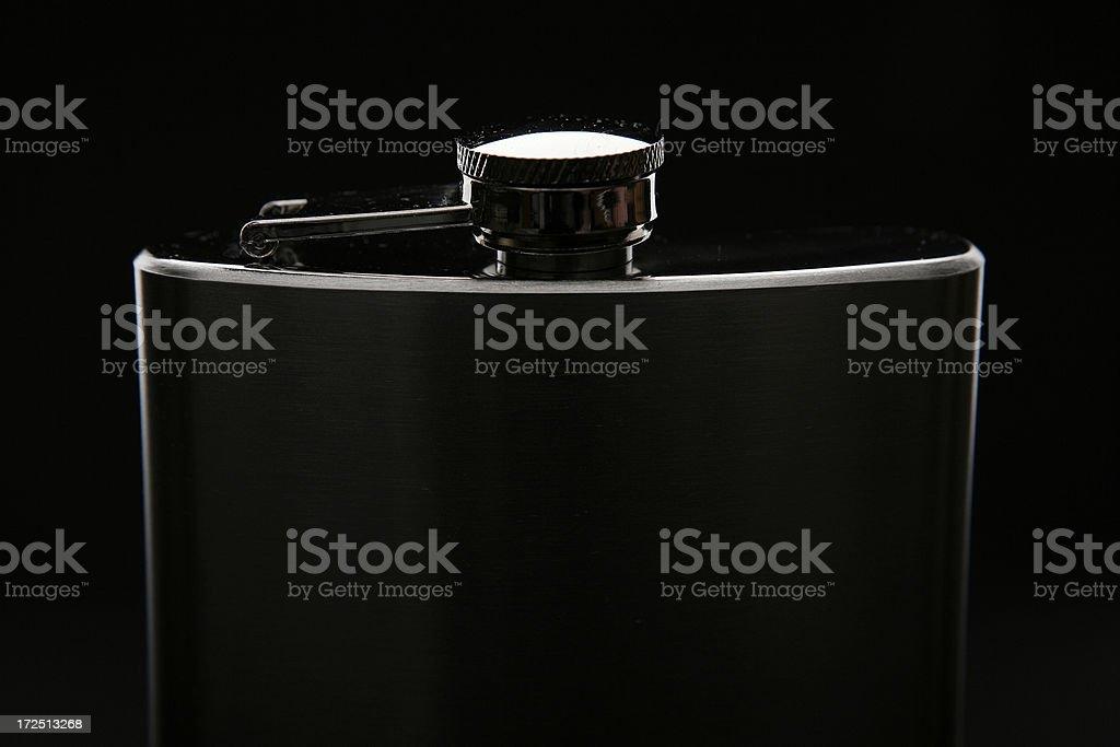 dark hip-flask on black background royalty-free stock photo