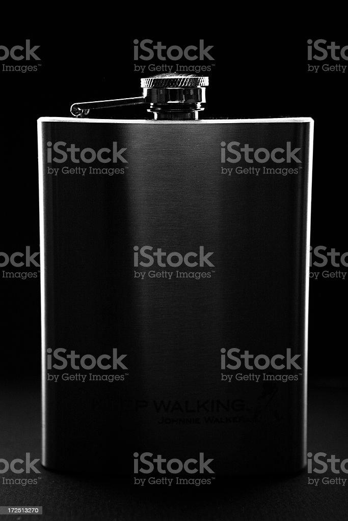dark hip-flask on black background stock photo