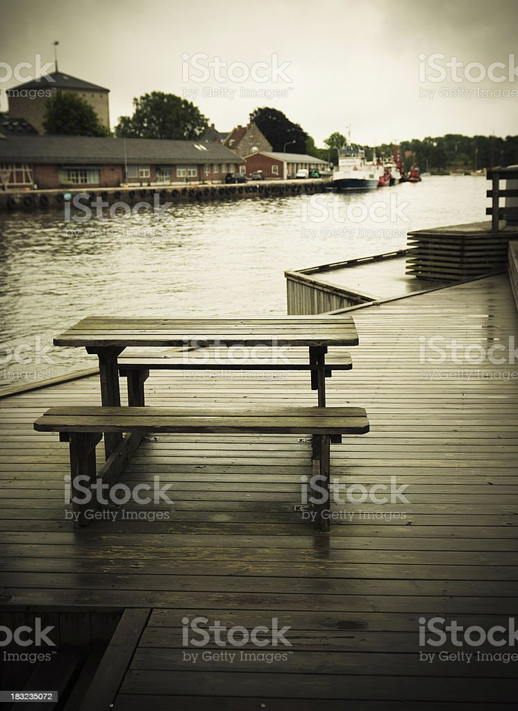 Dark Jetty in a small Harbour  - Norway royalty-free stock photo