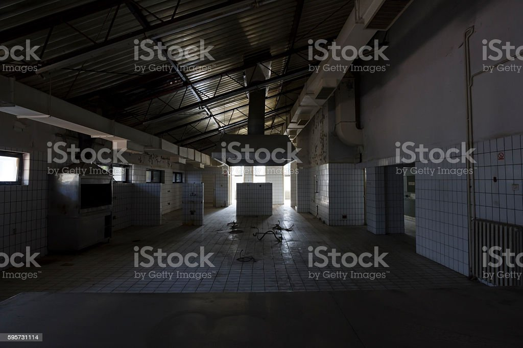 Dark kitchen in empty, old, abandoned hotel restaurant stock photo