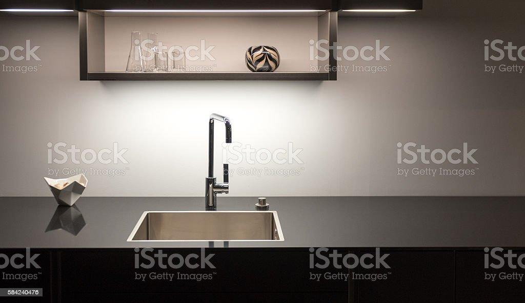 Dark Kitchen Sink stock photo