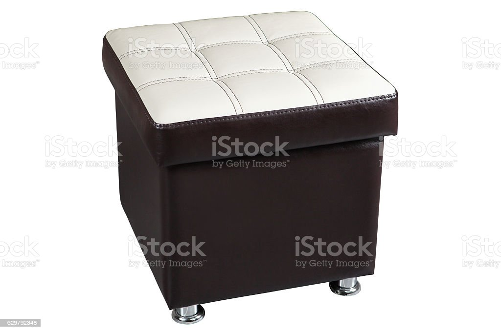 Dark leatherette ottoman chair seat with white top. stock photo