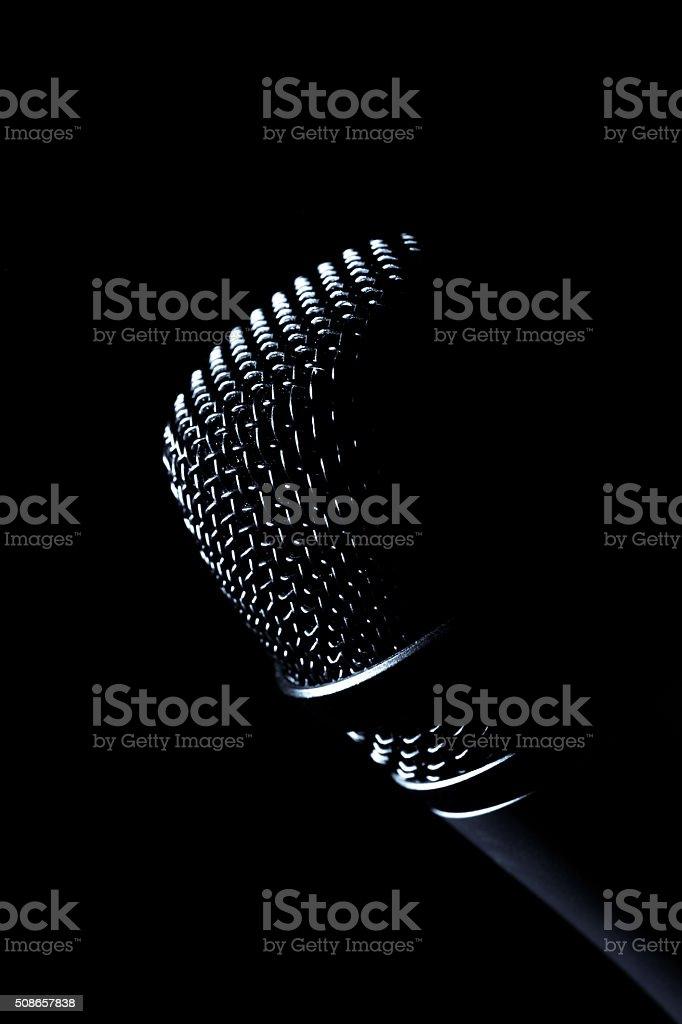 Dark microphone stock photo