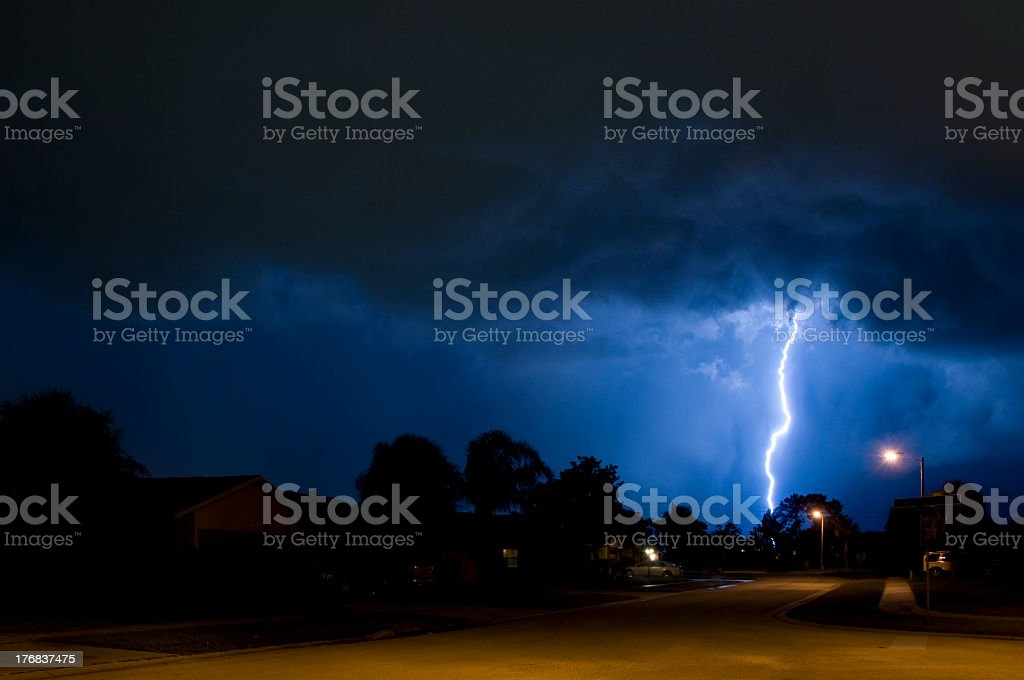 A dark night with a lightning strike royalty-free stock photo