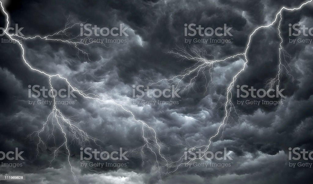 Dark, ominous rain clouds and lightning stock photo