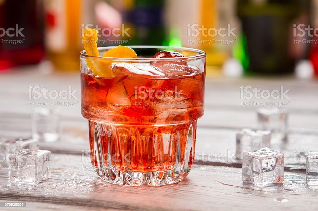Dark orange drink in glass. stock photo