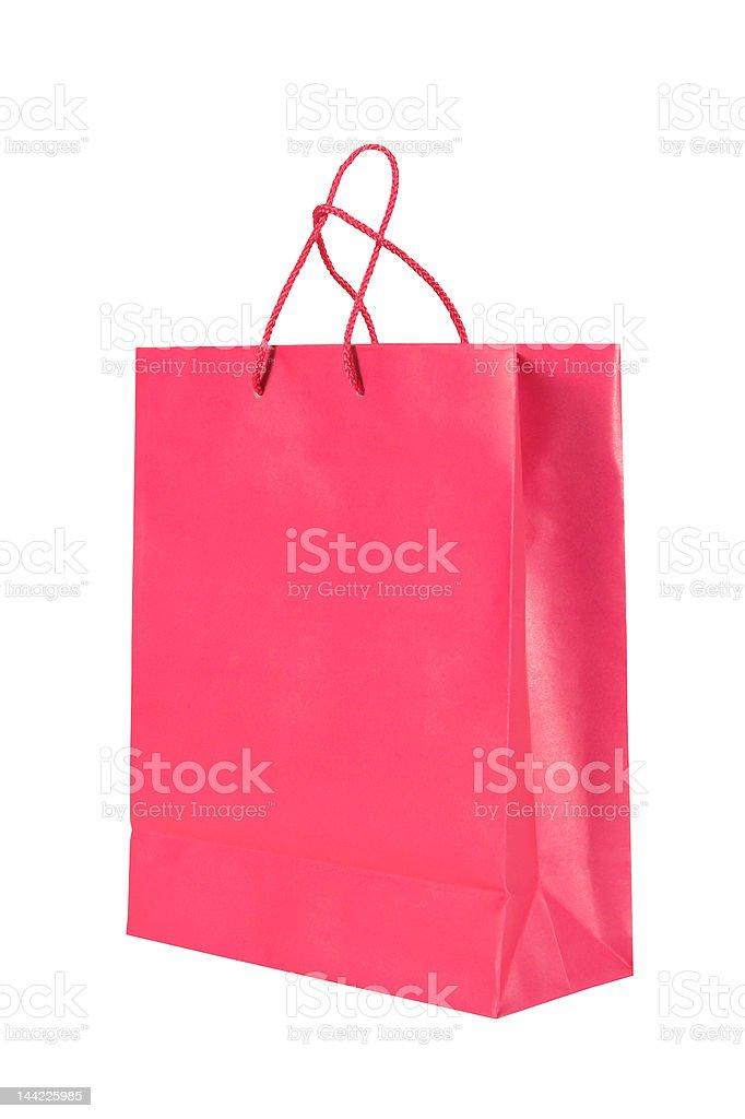 Dark pink paper shopping bag royalty-free stock photo
