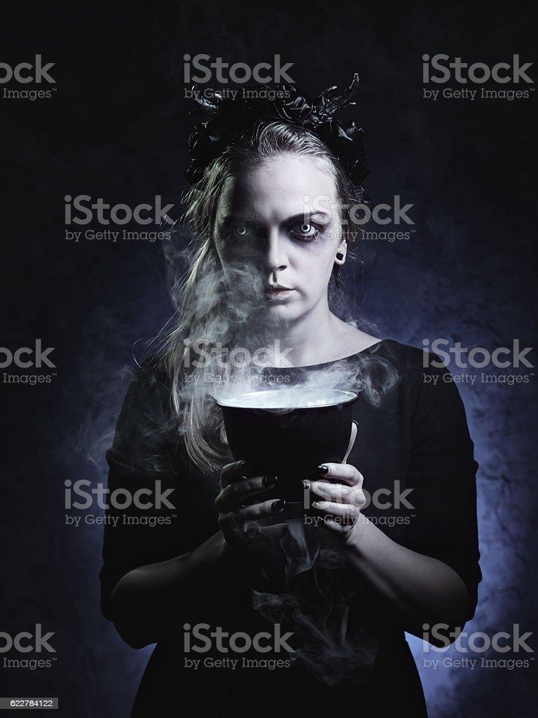 Dark portrait of evil witch in smoke stock photo