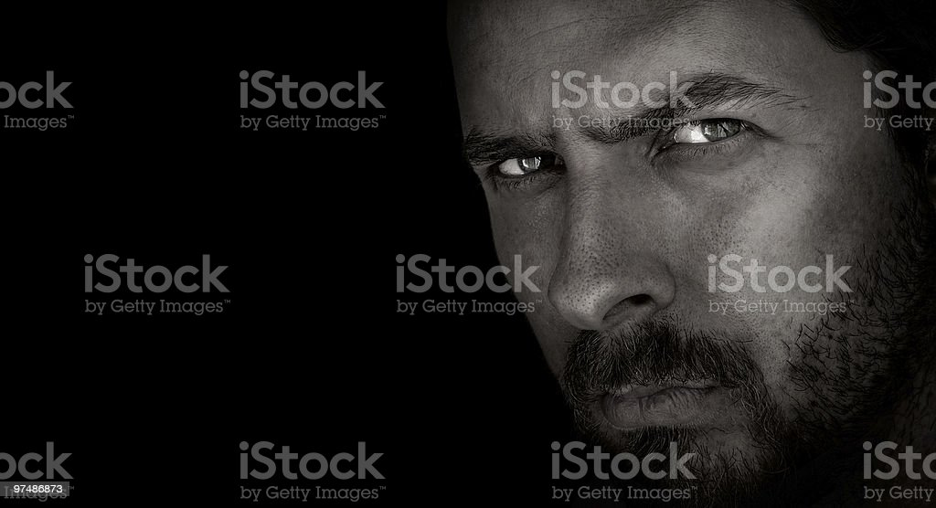 Dark portrait of scary man with evil eyes stock photo