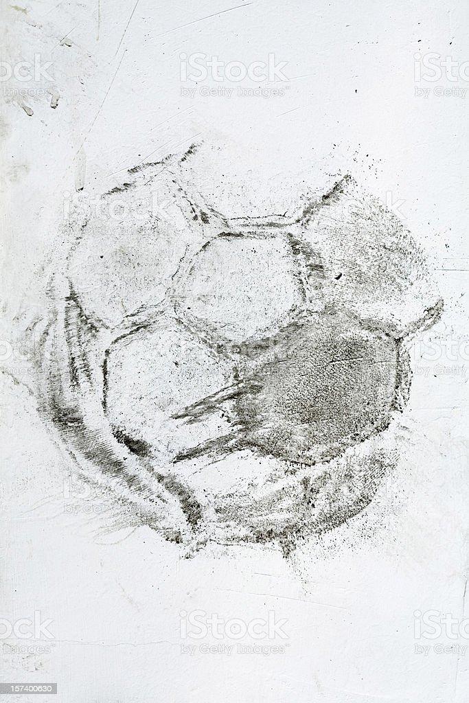 Dark print of soccer ball on white wall royalty-free stock photo