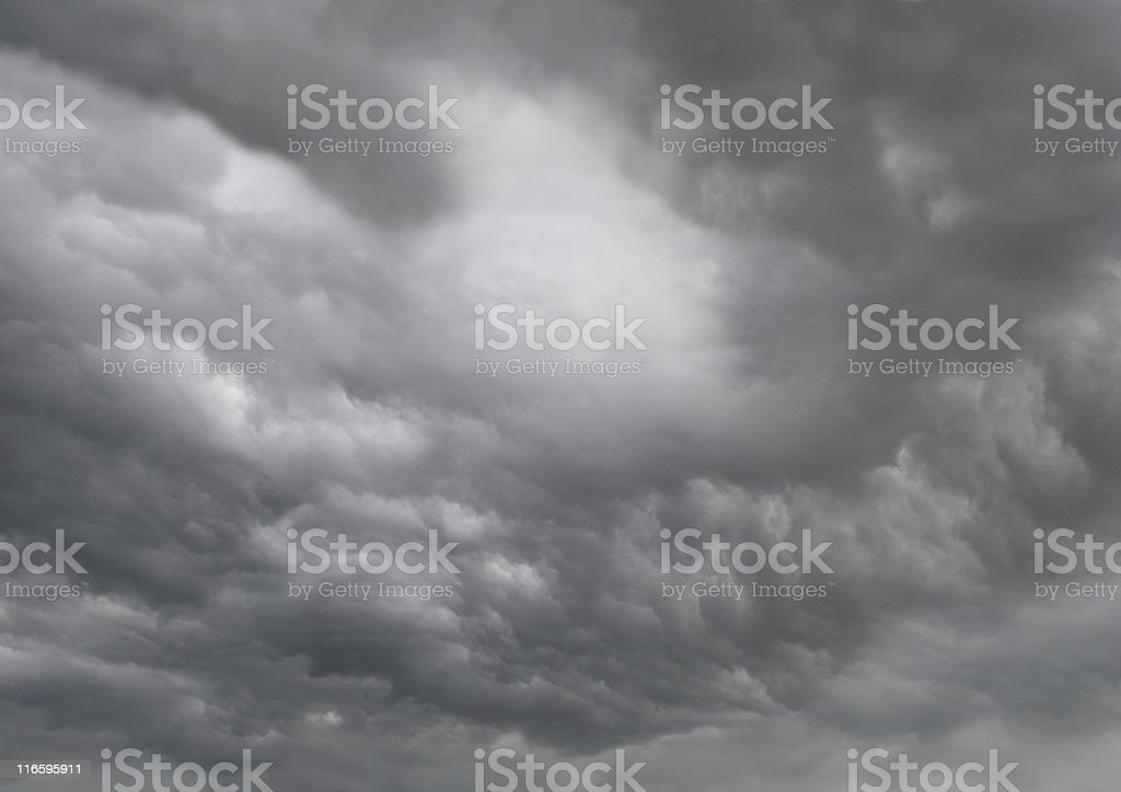 Dark rain and thunderstorm clouds stock photo