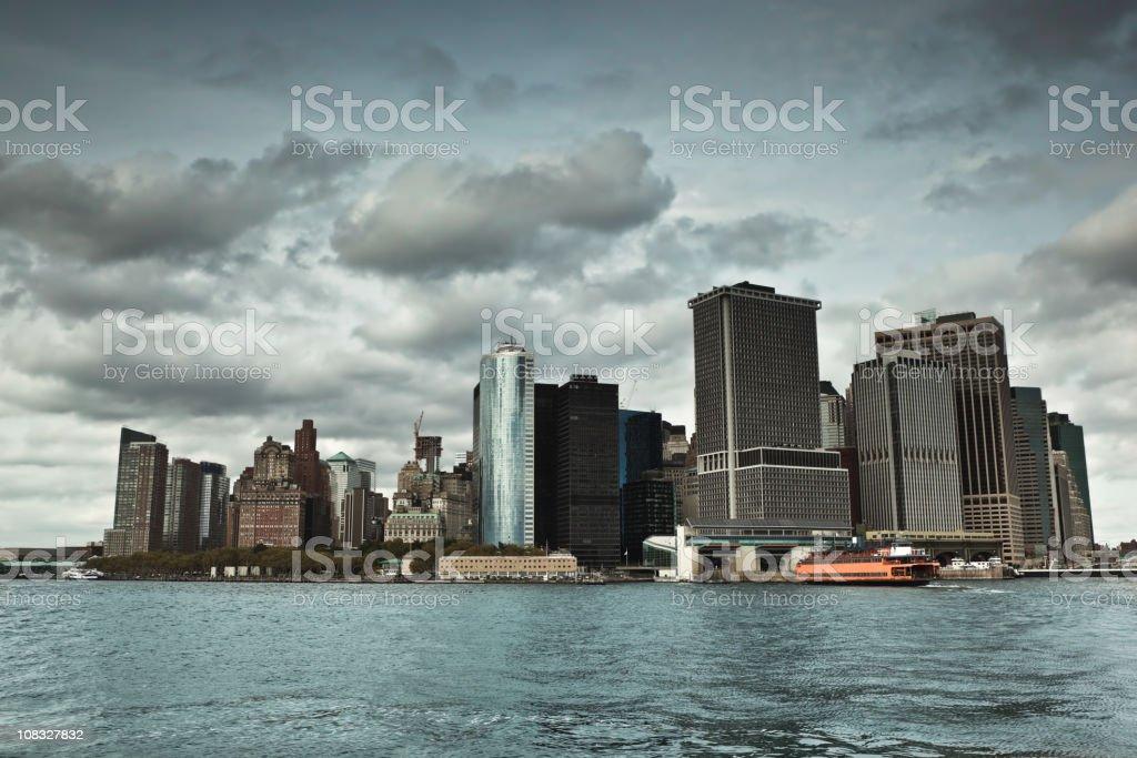 Dark rain clouds over Manhattan buildings royalty-free stock photo