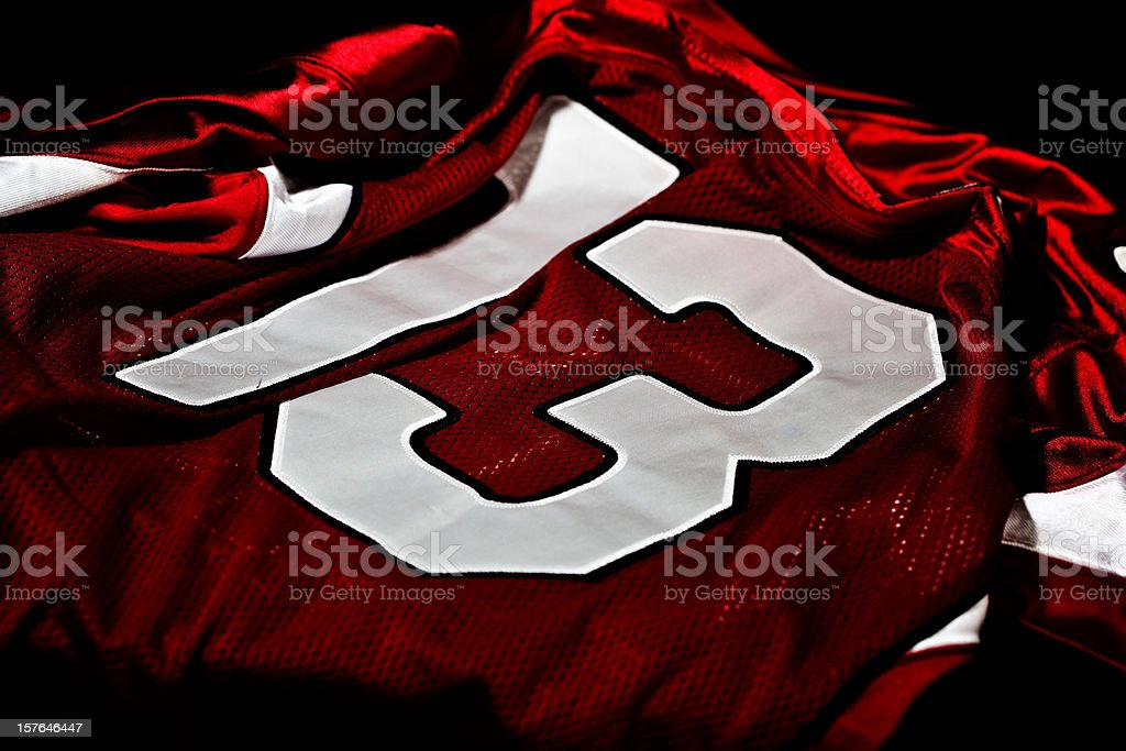 Dark red and white jersey with the number thirteen on it stock photo